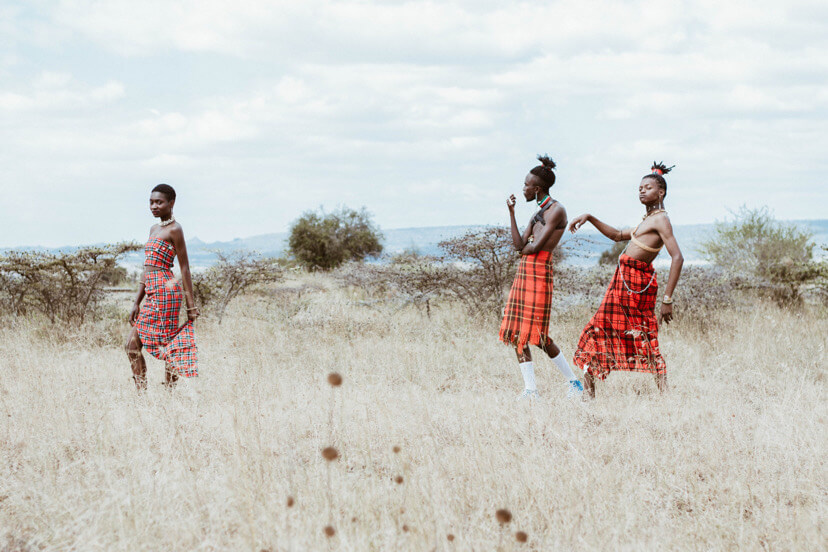 a woman and two men in the maasai mara, Kenya