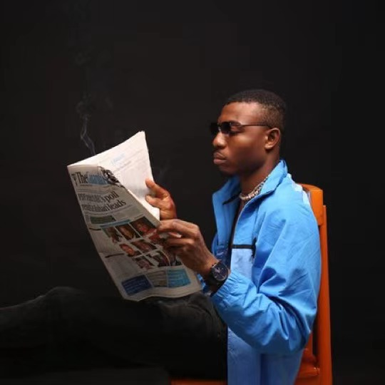 an african man reading a newspaper