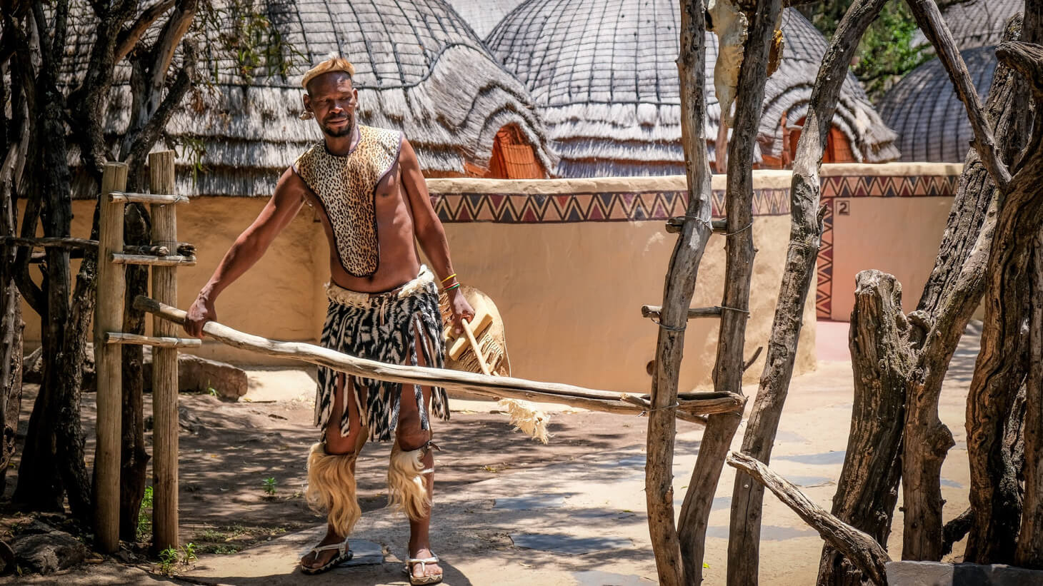 African man dresses in a cultural attire.